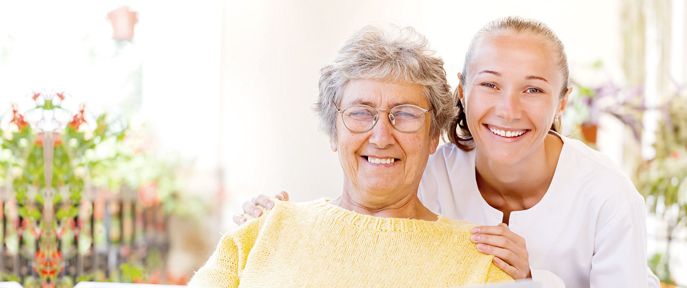 elderly woman and a young woman beside her
