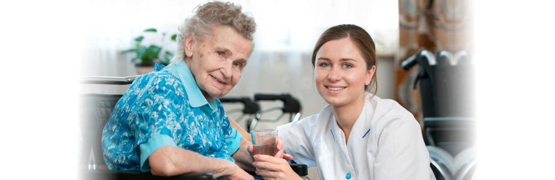 elderly woman and a caregiver at home