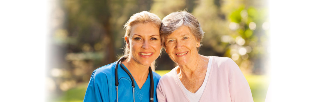 elderly woman and a young woman nurse